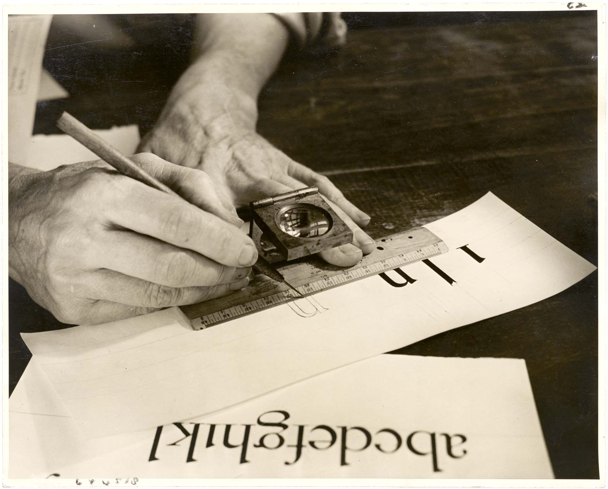 Photo of Dwiggins drawing letters