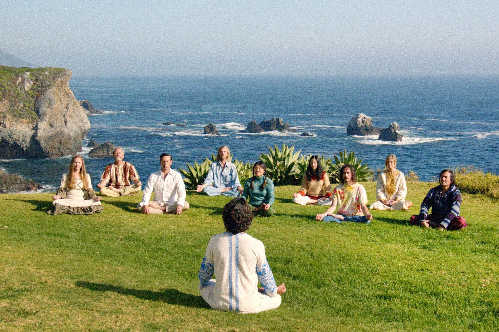 Still from the series finale of Madmen showing a group of people sitting in a circle meditating.